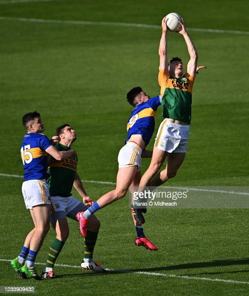 Tipperary , Ireland - 10 July 2021; Diarmuid OConnor of Kerry, supported by team-mate David Moran, wins possession from the throw-in at the start of...