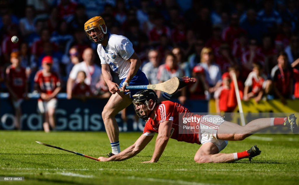 Tipperary , Ireland - 18 June 2017; Tommy Ryan of Waterford shoots under pressure from Mark Ellis of Cork during the Munster GAA Hurling Senior Championship Semi-Final match between Waterford and Cork at Semple Stadium in Thurles, Co Tipperary.