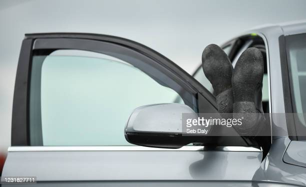 Tipperary , Ireland - 20 March 2021; A jockey relaxes in his car during racing at Thurles Racecourse in Tipperary.