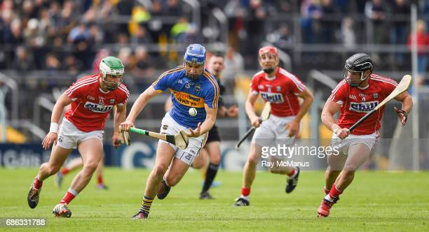 Tipperary Ireland 21 May 2017 John McGrath of Tipperary in action against Shane Kingston left and Colm Spillane of Cork during the Munster GAA...