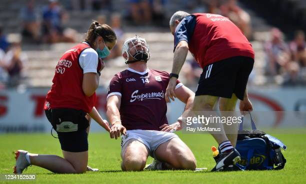 Tipperary , Ireland - 24 July 2021; Joe Canning of Galway is attended to by chartered physiotherapist Rachel Wyer and the team doctor Dr Ian O'Connor...