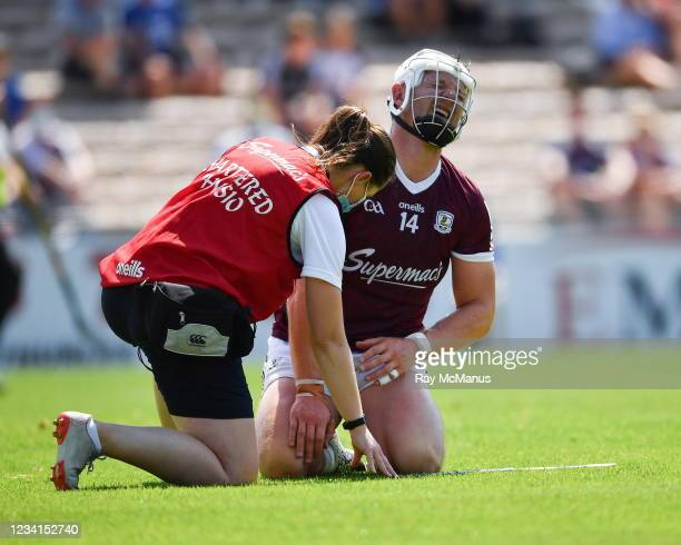 Tipperary , Ireland - 24 July 2021; Joe Canning of Galway is attended to by chartered physiotherapist Rachel Wyer after being struck on the wrist...