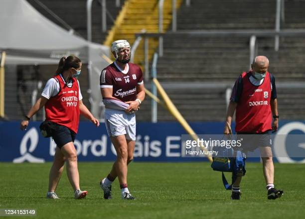 Tipperary , Ireland - 24 July 2021; Joe Canning of Galway leaves the field with chartered physiotherapist Rachel Wyer and the team doctor Dr Ian...
