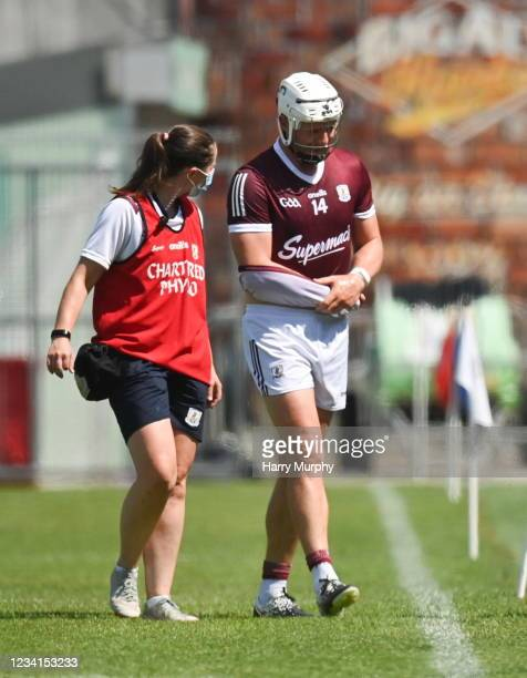 Tipperary , Ireland - 24 July 2021; Joe Canning of Galway leaves the field with chartered physiotherapist Rachel Wyer after being struck on the wrist...