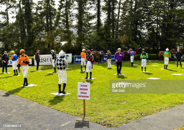 Tipperary , Ireland - 24 March 2020; Jockeys and trainers in the parade ring observe social distancing guidlines prior to the Money Back On The...