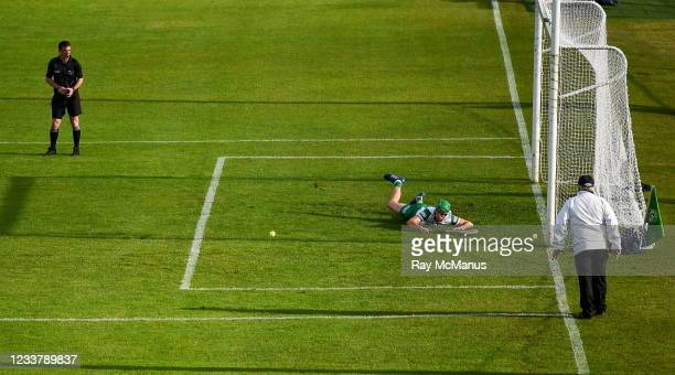 Tipperary , Ireland - 3 July 2021; Referee Paud O'Dwyer watches on as Limerick goalkeeper Nicky Quaid dives to his left to save a first half penalty...