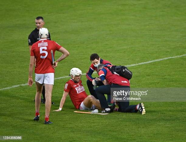 Tipperary , Ireland - 31 July 2021; Luke Meade of Cork receives medical attention for an injury during the GAA Hurling All-Ireland Senior...