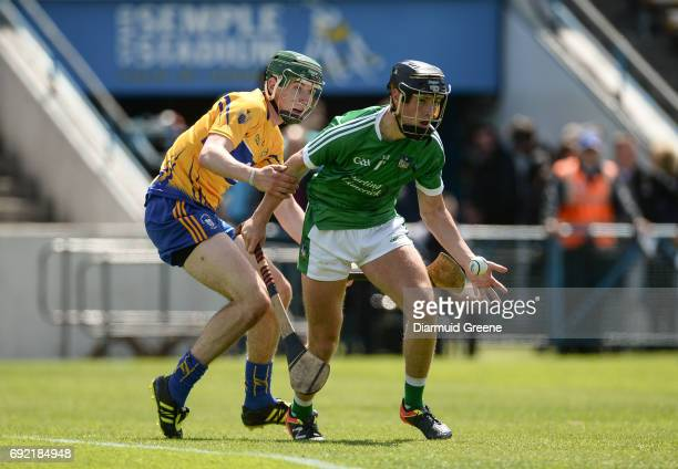 Tipperary , Ireland - 4 June 2017; Barry Murphy of Limerick in action against Ben O'Gorman of Clare during the Munster GAA Hurling U25 Championship...