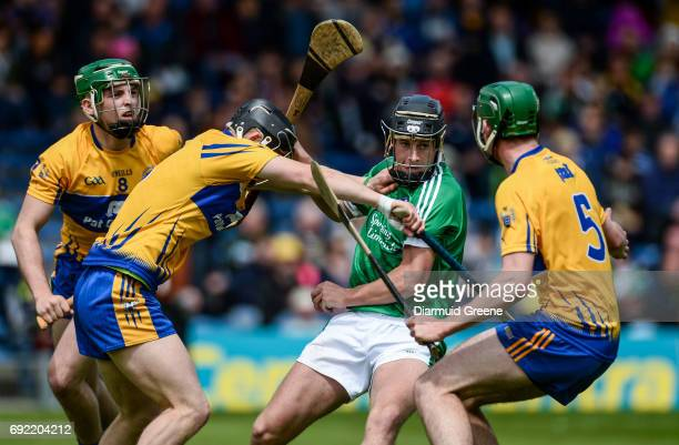 Tipperary , Ireland - 4 June 2017; Barry Murphy of Limerick in action against Michael O'Malley, left, Eoin Quirke, and Ben O'Gorman of Clare during...