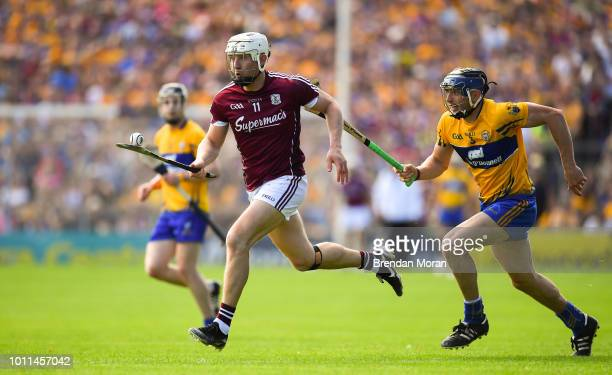 Tipperary Ireland 5 August 2018 Joe Canning of Galway races clear of David McInerney of Clare during the GAA Hurling AllIreland Senior Championship...