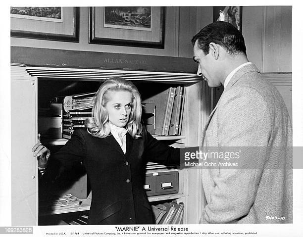 Tippi Hedren is caught by Sean Connery while trying to rifle his safe in a scene from the film 'Marnie' 1964