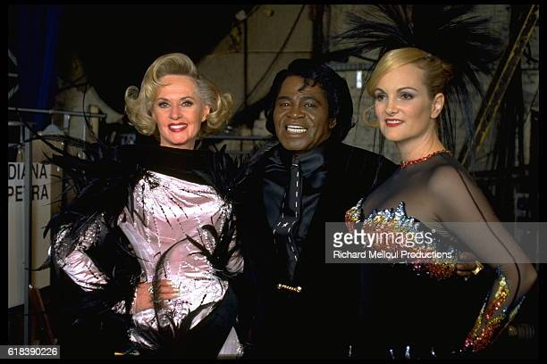 Tippi Hedren, James Brown and Patricia Hearst Posing for the Thierry Mugler Fashion Show