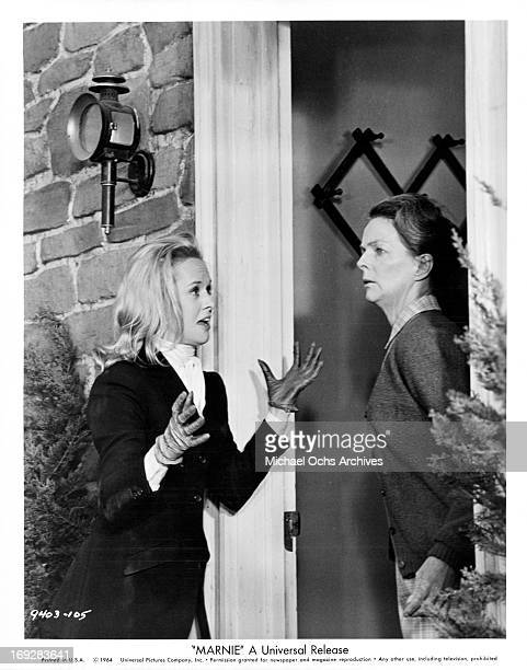 Tippi Hedren makes her way to the farm house of Meg Wyllie to ask for a gun in a scene from the film 'Marnie' 1964