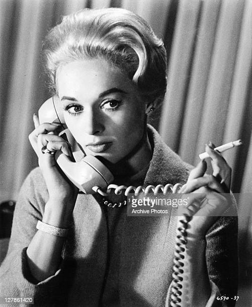 Tippi Hedren receives phone call in a scene from the film 'The Birds' 1963