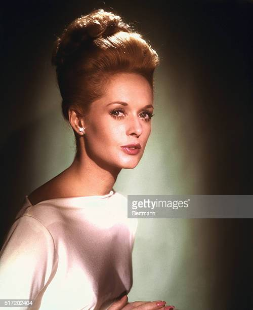 Tippi Hedren who plays the title role in Alfred Hitchcock's Marnie sex mystery in which she stars with Sean Connery a Universal release in...