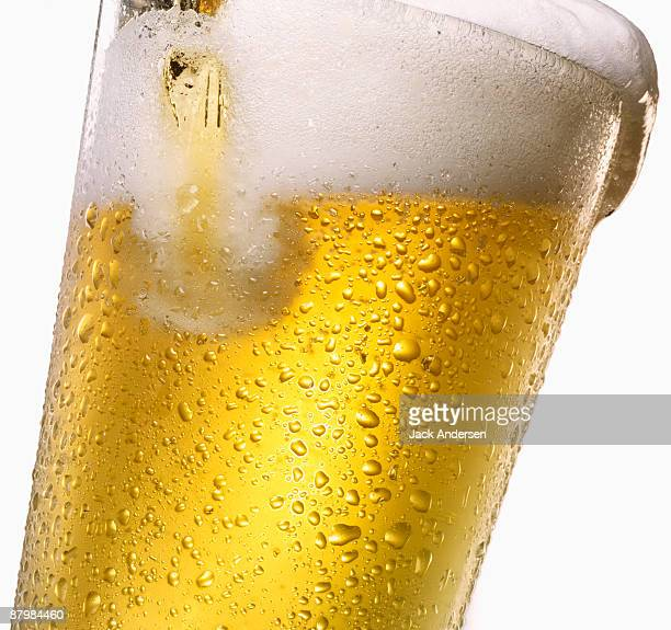 Tipping glass of beer
