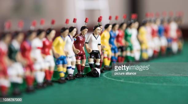 24 TippKick figurines in the colours of the 24 countries participating in the Euro 2016 lie on a desk at the production site of toy producer TippKick...