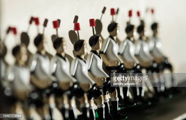 TippKick figurines in the colours of the German national soccer team lie on a desk at the production site of toy producer TippKick in...