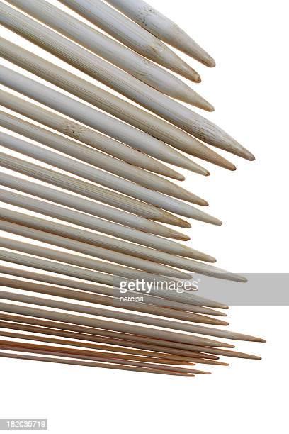 Tips of bamboo knitting needles on white