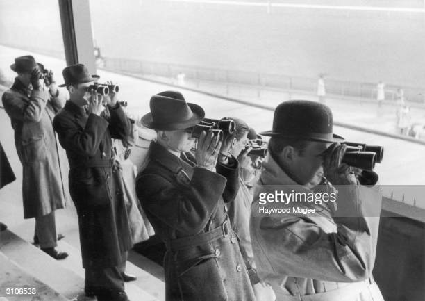 Tipsters checking the form at the Newmarket Races 1953 Picture Post 6563 The TipstersNewmarket unpub