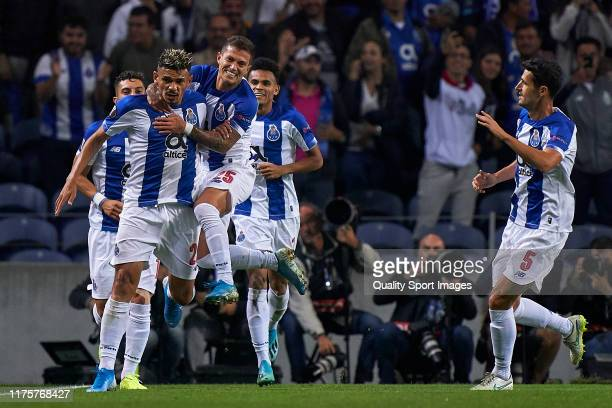 Tiquinho Soares of FC Porto celebrates with his team mates after scoring his team's first goal during the UEFA Europa League group G match between FC...