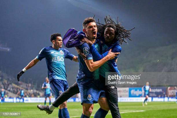 Tiquinho Soares of FC Porto celebrates with Romario Baro after scoring his team's second goal during the Taca da Liga Allianz CUP semifinal match...