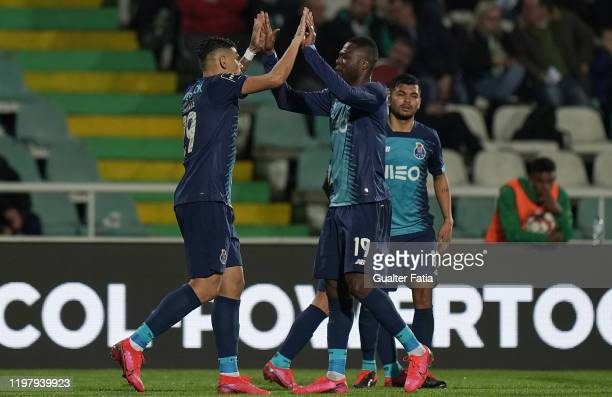 Tiquinho Soares of FC Porto celebrates with teammate Chancel Mbemba of FC Porto after scoring the third goal of their team during the Liga NOS match...