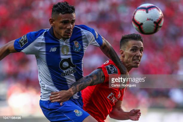 Tiquinho Soares of FC Porto vies with Alex Grimaldo of SL Benfica for the ball possession during the Liga NOS round 7 match between SL Benfica and FC...