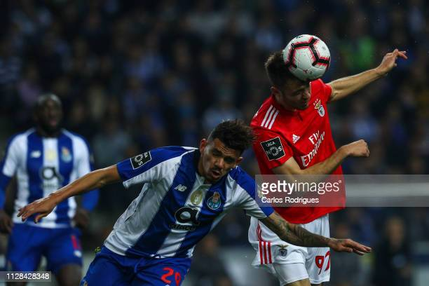 Tiquinho Soares of FC Porto vies with Francisco Ferreira of SL Benfica for the ball possession during the Liga NOS match between FC Porto and SL...