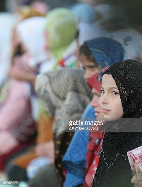Albanian girls and women pray next to a mosque on the first day of the Muslim festival marking the end of the holy month of Ramadan in Tirana 03...
