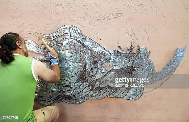 Albanian painter Saimir Strati works on the selfportrait of Leonardo Da Vinci using industrial nails at the International Centre of Culture in Tirana...