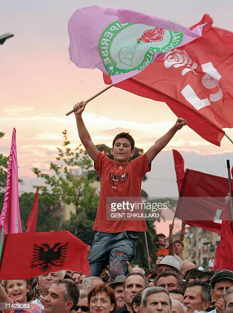 An Albanian boy brandishes a flag during a oppositions protest rally against the Government in central Tirana 12 July 2006 The Albanian opposition...