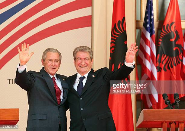 US President George W Bush and Albanian Prime Minister Sali Berisha wave at the conclusion of a joint press conference 10 June 2007 in the courtyard...