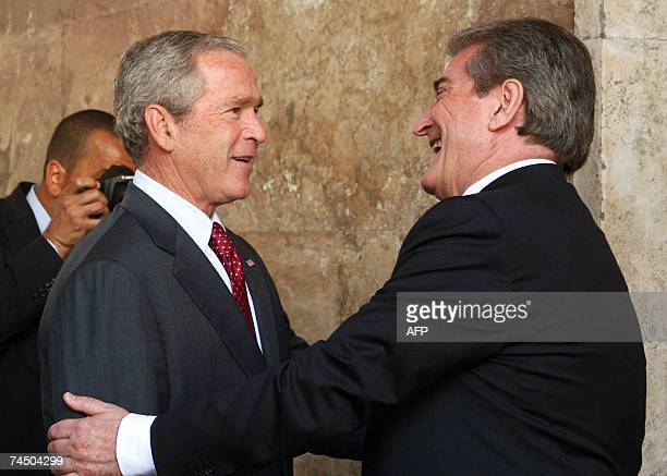 US President George W Bush and Albanian Prime Minister Sali Berisha meet 10 June 2007 in the courtyard of the Council of Ministers in Tirana Bush...