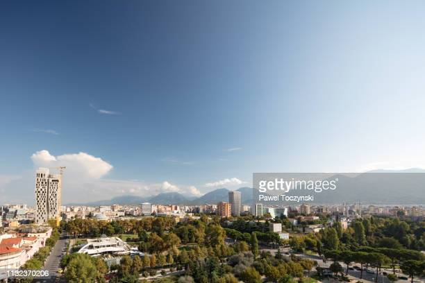 tirana's downtown area with the tallest building in the city - the plaza tirana (85m), albania, 2018 - socialism stock pictures, royalty-free photos & images