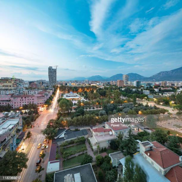 tirana's downtown area with the tallest buildings in the city - the plaza tirana at sunset (85m, on right) and 4 ever green tower (left) at sunset, albania, 2018 - socialism stock pictures, royalty-free photos & images