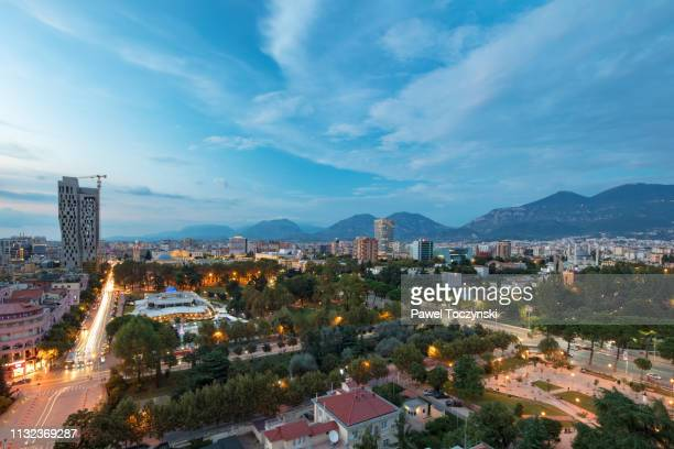 tirana's downtown area with the tallest buildings in the city - the plaza tirana at sunset (85m, on right) and 4 ever green tower (left), albania, 2018 - socialism stock pictures, royalty-free photos & images
