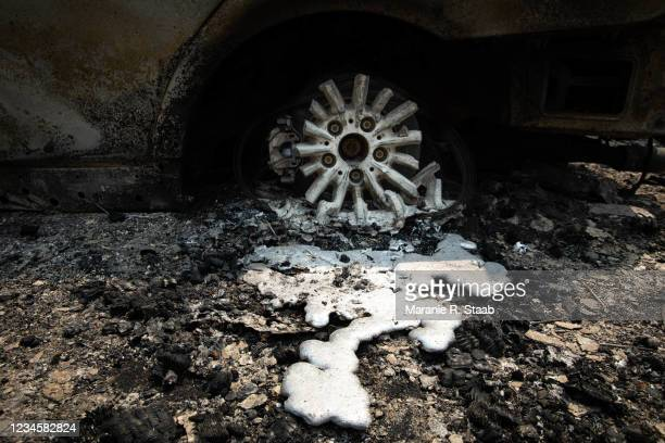Tire and wheel melted from the Dixie Fire on August 8, 2021 in Greenville, California. The Dixie Fire, which has incinerated more than 463,000 acres,...