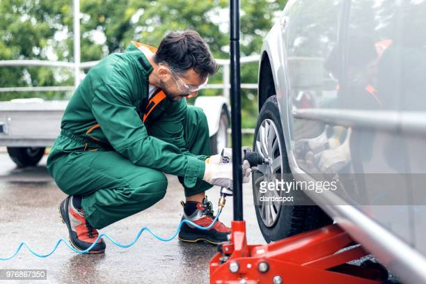 tire changing at car service - replacement stock pictures, royalty-free photos & images