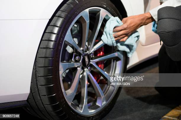 A tire from French manufacturer Michelin is on a Cadillac CTS during the 2018 North American International Auto Show in Detroit Michigan on January...
