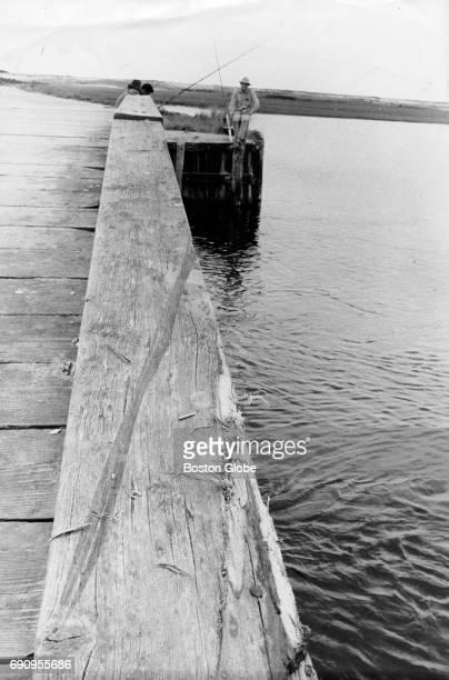 Tire marks of Senator Edward M Kennedy's car on Dyke Bridge leading into the water on Chappaquiddick Island off the coast of Martha's Vineyard on...