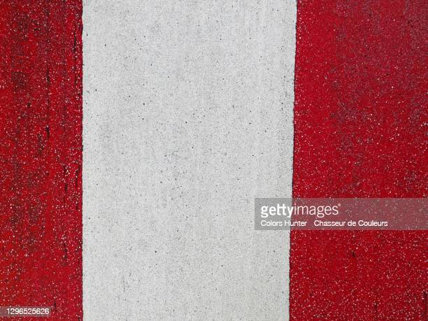 tire marks on a white and red painting on a street in brussels - tar stock pictures, royalty-free photos & images