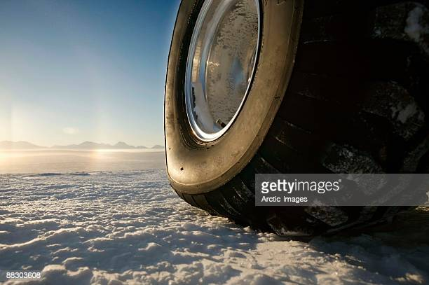 Tire of vehicle on snowy glacier, Iceland