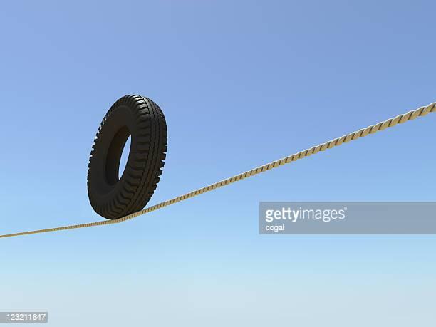 Pneu em uma corda bamba.