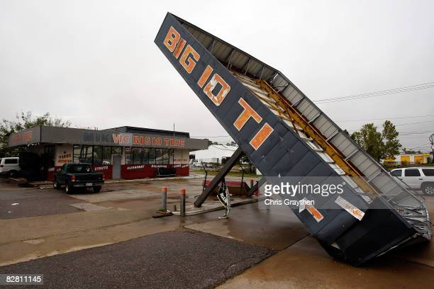 A tire repair store is damaged from high winds from Hurricane Ike September 14 2008 in Houston Texas Ike caused extensive damage along the Texas Gold...
