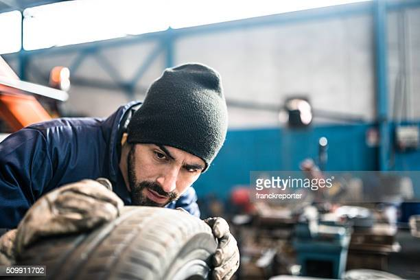 tire repairer checking the tire integrity