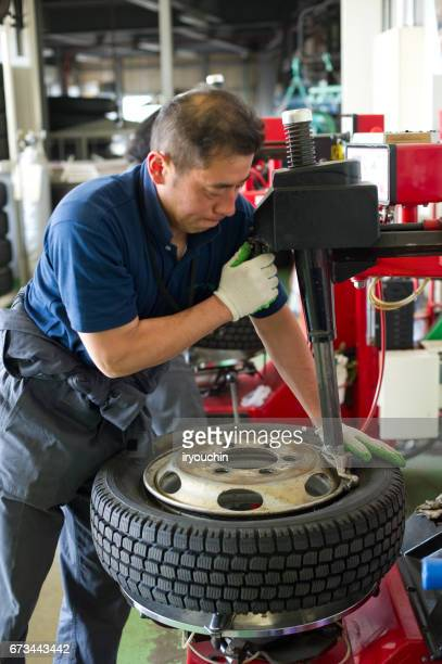 tire shop - work glove stock photos and pictures