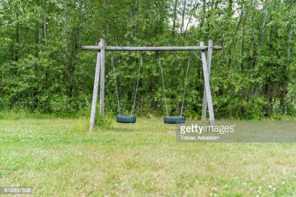 Tire swing on green field