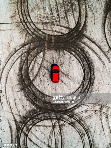 tire tracks and a vehicle on a beach as seen from above, france - donut stock pictures, royalty-free photos & images