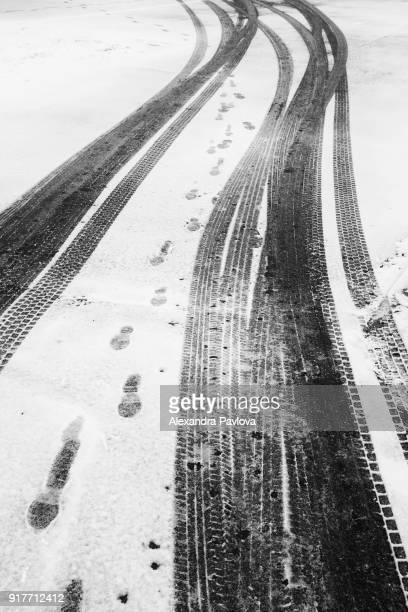 tire tracks and footprints in the snow - alexandra pavlova stock pictures, royalty-free photos & images